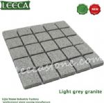 Tumbled light gray granite cobble stone mat