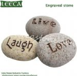 Cobble stone with words engraved stone