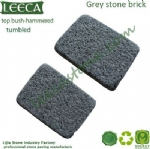 Bush hammered grey granite stone brick